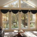 Carol Schenck, of Boonville, wanted a treatment that wouldn't hide her lovely view of the woods.  When she needs privacy or light control she simply pulls pleated gauze panels together.