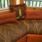 The window seat pillows and cushions for a contemporary woodland getaway.