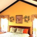 The woman of the house wanted something beautiful for the master bedroom of this country lodge.  The man of the house wanted to be able to see the white tails of the deer on his ridge.  By raising the treatments, both were happy!