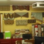 Here is part of a wall in our store, just covered with new window treatments.  One wall down and three more to go!