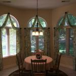 Charles and Jo Burks have a beautiful dining area that looks out onto the woods.  They wanted to finish off the room and enhance the view with window treatments.  Jo chose a gorgeous floral botanical fabric with birds.